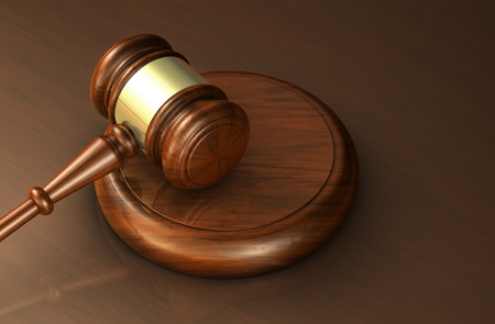 lawer: Law, lawyer and justice concept with a close-up 3d rendering of a gavel on a wooden brown desktop for banner and law firm background.