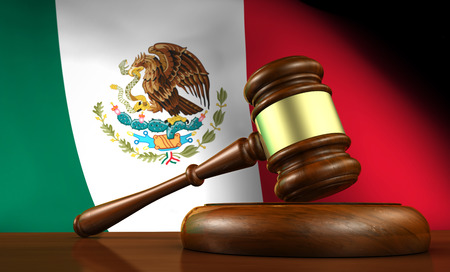 government regulations: Law and justice of Mexico concept with a 3d rendering of a gavel on a wooden desktop and the Mexican flag on background.