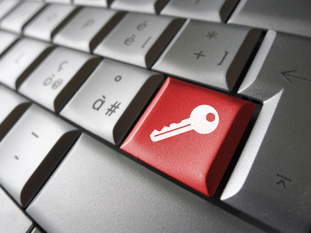 computer net: Access key Internet security concept with key icon and symbol on a red laptop computer key for website, blog and on line business.