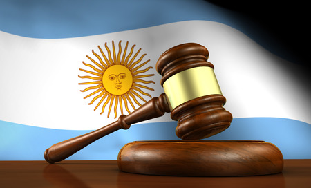 argentinian flag: Law and justice of Argentina concept with a 3d render of a gavel on a wooden desktop and the Argentinian flag on background.