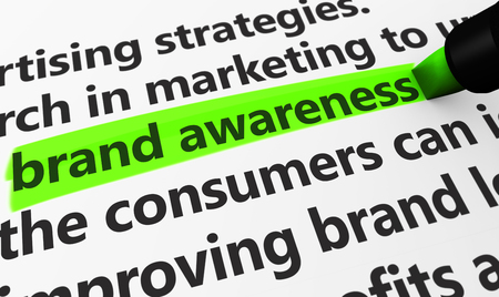 brand: Marketing and advertising concept with a 3d rendering of brand developing strategies related words and brand awareness text highlighted with a green marker. Stock Photo
