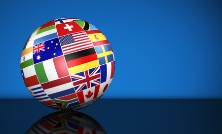 Travel, services, education and international business management concept with a globe and international flags of the world on blue background with copy space.
