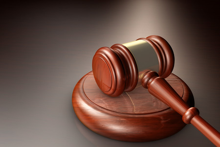 Judge, law, lawyer and Justice concept with a close-up 3d render of a gavel on a wooden desktop. Standard-Bild