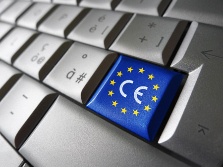 law: European Union and EU community CE marking concept with sign, symbol and EU flag on a computer key.