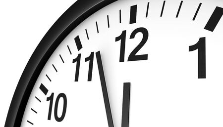 twelve: Time concept with a close-up face view of a black and white wall clock with clean design showing almost midnight hour.
