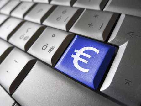 financial symbol: European Union financial concept image with euro symbol, sign and icon on a blue laptop computer key for blog, website and online business.