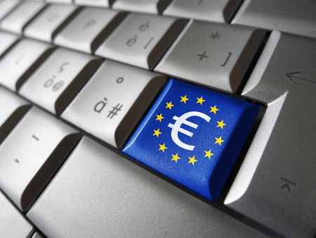 European Union financial concept image with euro symbol, sign and icon on a laptop computer key with EU flag for blog, website and online business.