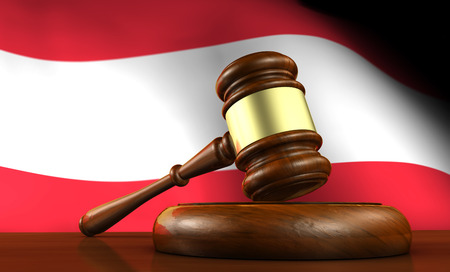 constitutional law: Law and justice of Austria concept with a 3d render of a gavel on a wooden desktop and the Austrian flag on background.