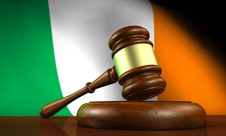 irish flag: Law and justice of Ireland concept with a 3d render of a gavel on a wooden desktop and the Irish flag on background. Stock Photo