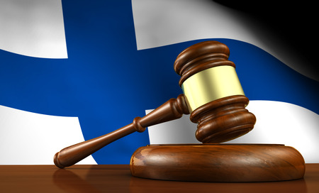 constitutional law: Law and justice of Finland concept with a 3d render of a gavel on a wooden desktop and the Finnish flag on background.
