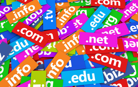 registration: Web and Internet domain names concept background with a moltitude of website domains signs and text on scattered colorful paper.