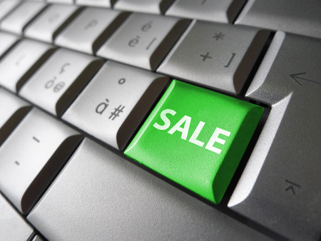 internet sale: Online sales web and Internet concept with sale sign and word on a green laptop computer key for blog, website and online business.
