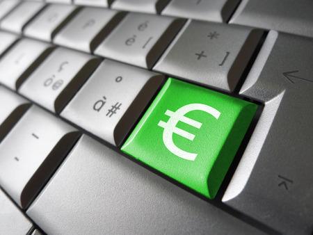 icono computadora: Concepto de imagen financiera de la Unión Europea con el símbolo del euro, señal y el icono de una tecla del ordenador portátil verde para el blog, sitio web y negocio en línea. Foto de archivo