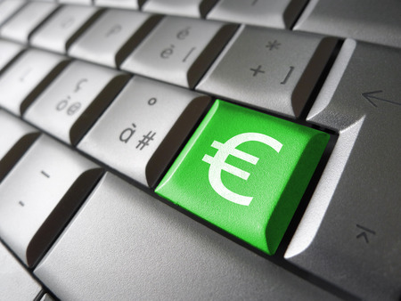 financial symbol: European Union financial concept image with euro symbol, sign and icon on a green laptop computer key for blog, website and online business.