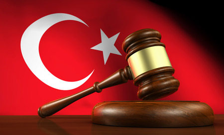 justice: Turkish law, legal system and justice concept with a 3d render of a gavel on a wooden desktop and the flag of Turkey on background. Stock Photo