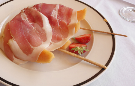 ham: Fresh summer Italian food close-up with ham, melon and strawberry.