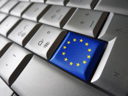 european community: European Union and EU community parliament concept with EU flag on a computer key.