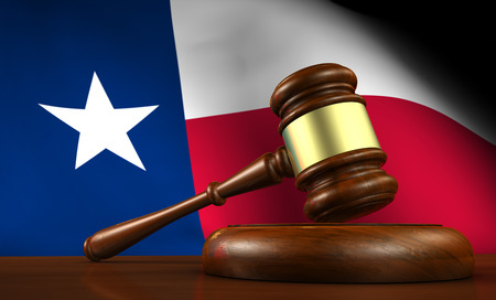 Texas law, legal system and justice concept with a 3d render of a gavel on a wooden desktop and the Texan flag on background. Stock Photo
