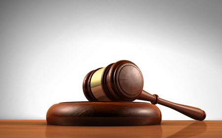 Law, justice and legal system concept with a wooden gavel judge symbol on a desktop. Stock Photo