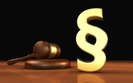 legal icon: Law, legality and legal system concept with a golden paragraph symbol and a wooden gavel on a desktop with black background. Stock Photo