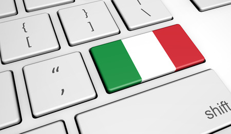 italy culture: Digitalization and use of digital technologies in Italy with the Italian flag on a computer key.