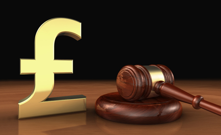 insurance claim: Law, lawyer and money with UK pound sterling icon and symbol and a judge gavel on a wooden desktop cost of justice concept.