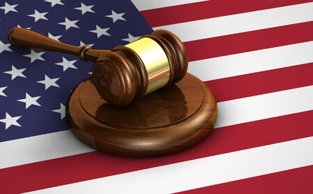 constitutional law: US law and justice of The United States of America concept with a 3d render of a gavel and the flag of USA on background.