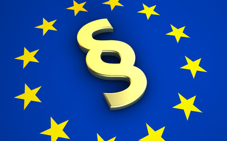 EU: European community law, rules and legal system concept with EU flag and golden paragraph symbol. Stock Photo