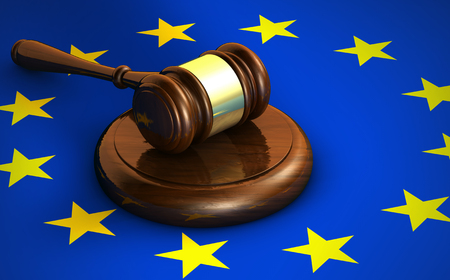 the european economic community: European Union Community laws, legal system and parliament concept with a 3d render of a gavel and the EU flag on background.