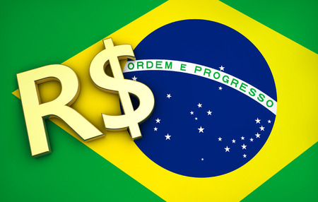 money symbol: Brazils economy concept with Brazilian flag and real money currency golden symbol. Stock Photo