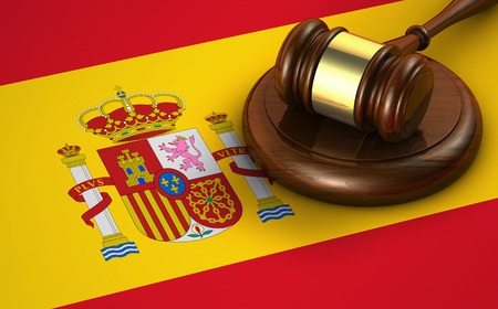 justice: Law, legal system and justice of Spain concept with a 3d rendering of a gavel and the Spanish flag on background. Stock Photo