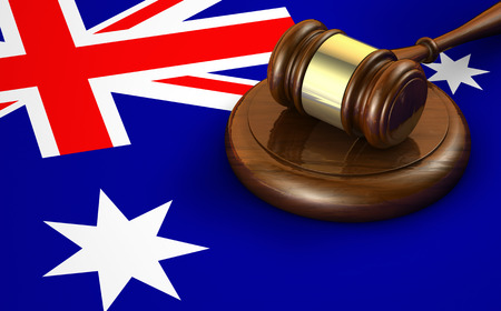 constitutional law: Law, legal system and justice of Australia concept with a 3d rendering of a gavel and the Australian flag on background.