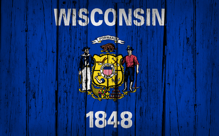 wisconsin flag: Wisconsin state grunge wood background with Wisconsinite flag painted on aged wooden wall.
