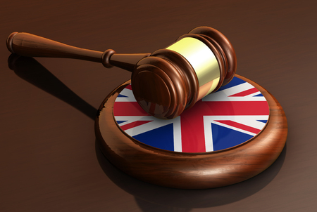 uk: Uk law, justice and United Kingdom legal system concept with a 3d rendering of a wooden gavel and the Union Jack flag.