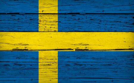 aged wood: Sweden grunge wood background with Swedish flag painted on aged wooden wall.