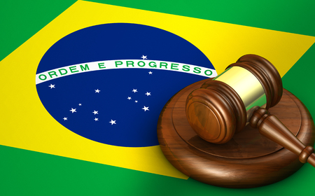 law of brazil: Brazil law, legal system and justice concept with a 3D rendering of a gavel and the Brazilian flag on background.