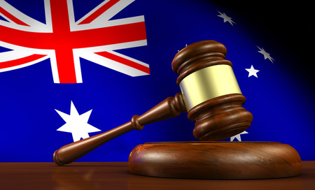 judicial system: Australia laws, legal system and justice concept with a 3D illustration of a gavel and the Australian flag on background.