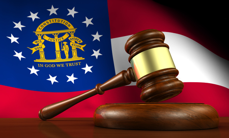 legality: Georgia state laws, legal system and justice concept with a 3D rendering of a gavel and the Georgian flag on background.