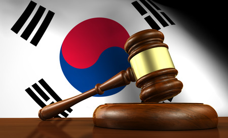South Korea laws, legal system and justice concept with a 3D rendering of a gavel and the South Korean flag on background. Banco de Imagens
