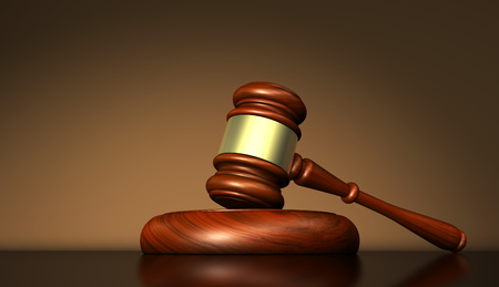 Law justice and judge symbol concept with a gavel on a wooden desktop 3D illustration. Stock Photo
