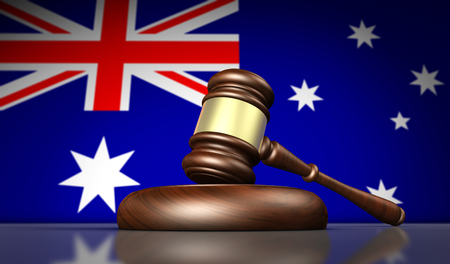 Australia laws, justice and legal system concept with a gavel and the Australian flag on background 3D illustration. Stock Photo