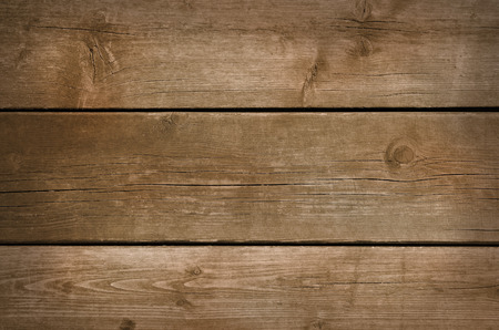 aged wood: Wooden background with grunge weathered and aged brown wood texture.