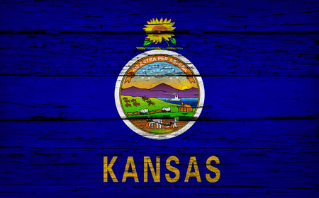 Kansas US State grunge wood background with Kansan flag painted on aged wooden wall. Stok Fotoğraf
