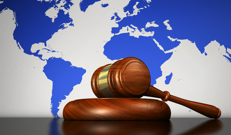 International law, justice, human rights and global business concept with a gavel and the world map on background 3D illustration.