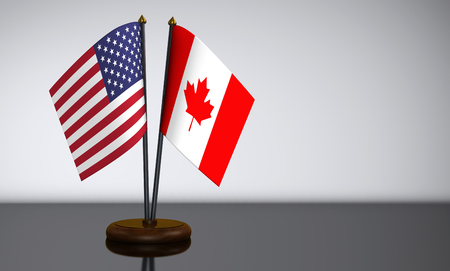 bilateral: US flag and Canadian desk flags 3D illustration.