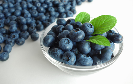 Blueberries cup healthy fresh summer antioxidant fruit background. Stok Fotoğraf