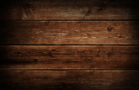 aged wood: Dark wood background with grunge weathered and aged brown wooden texture. Stock Photo