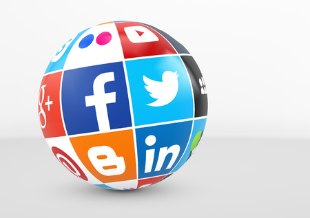internet globe: MILAN, ITALY - DECEMBER 7, 2015: Social media and network logotypes of famous Internet brands like Facebook, Twitter, Linkedin and  YouTube printed on a globe.