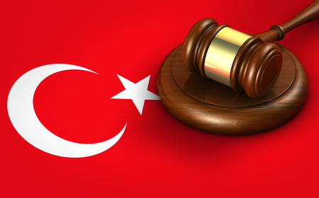 Turkey law, legal system and justice concept with a 3D rendering of a gavel on Turkish flag.