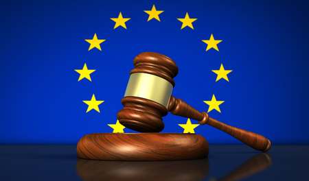 European Union laws, legislation and parliament concept with a 3D rendering of a gavel and the EU flag on background.